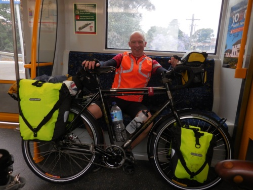Dave on the train with his new hi-vis bags