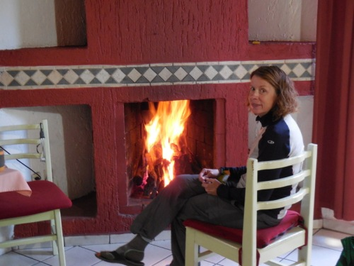 Our room - Nancy liking the fire