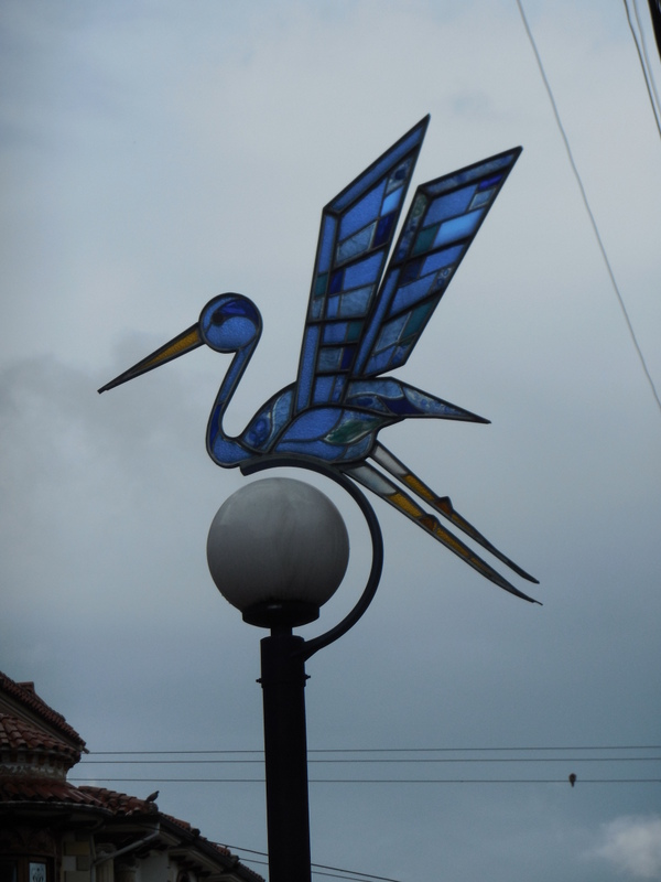 Otavalo has stained glass over their street lites