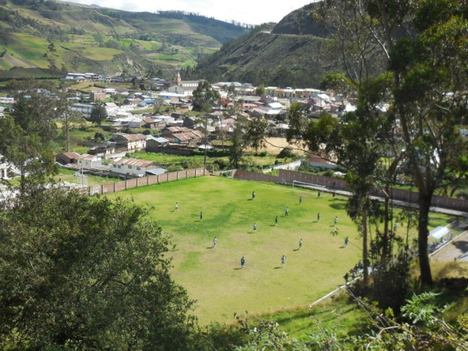 Looking down on town and a soccer match