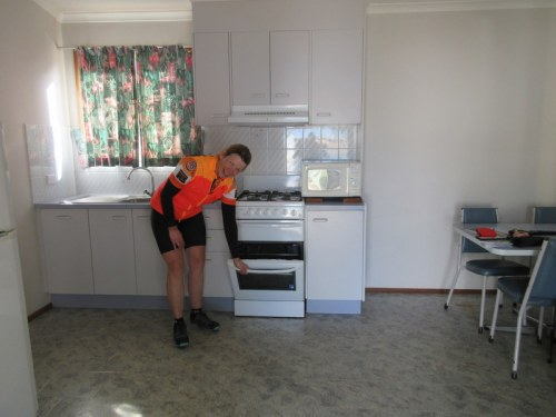 Nancy being domestic in our 1950s cabin